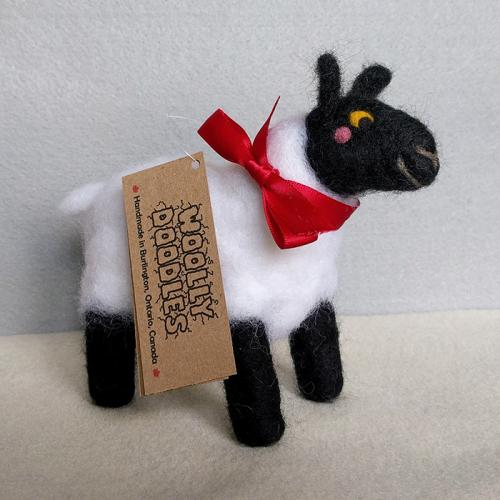 Needle felt sheep figure with a bow
