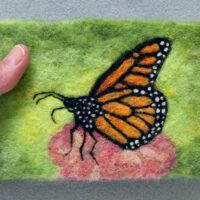 Monarch_butterfly_in_hand